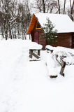 Wooden house in snow winter park Royalty Free Stock Photos