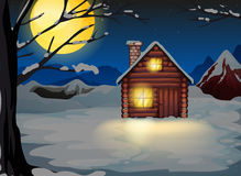A wooden house in a snowy area Stock Images