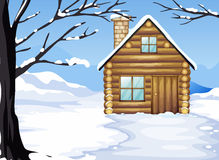 A wooden house in a snowy season Royalty Free Stock Photography