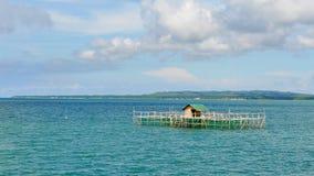 Wooden house on stilts at Cebu sea Stock Photos