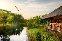 Wooden house at sunrise Stock Photography