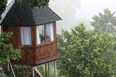 Wooden house on supports Royalty Free Stock Photo