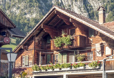 Wooden house. In Switzerland with balcony. Alpine mountains in the background Stock Photo