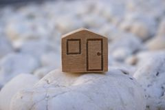 Wooden house symbol Stock Photo