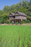 Wooden house in Thai style locate on rice field. Wooden house in Thai style locate on rice field, Thailand Stock Photography