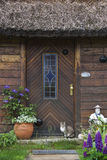 Wooden house with thatched roof Royalty Free Stock Photography