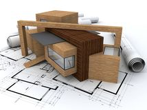 Wooden house on top of blueprints stock photo