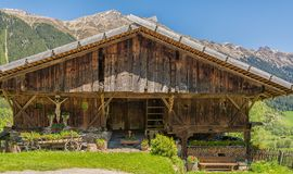 Wooden house typical in a alps village on Ridnaun Valley/Ridanna Valley - Racines country - near Sterzing/Vipiteno, South Tyrol, n royalty free stock image