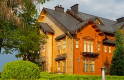 Wooden house Ukraine home building. Large wooden house in a sunset light. Ukraine royalty free stock photo