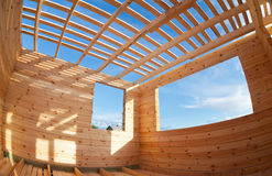 Wooden house under construction Stock Photos