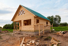 Wooden house under construction Stock Images