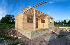 Wooden house under construction Royalty Free Stock Image