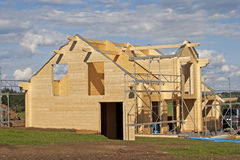 Wooden house under construction. Family build new home in green landscape. super commercial stock photo