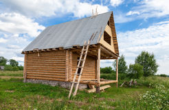 Wooden house under construction Stock Image