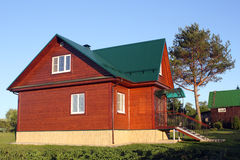 Wooden house under green metal roof Stock Photo