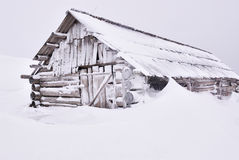 Wooden house under snow Stock Photo