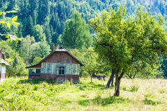 Wooden house with veranda. Old wooden house with veranda in ukrainian village Prokurava at the foot of the Carpathian mountains Royalty Free Stock Photos