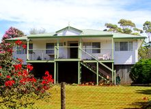 Modern Australian home with veranda and garden, Queensland, Australasian. Wooden house with veranda and a garden with blooming flowers in Tamborine Mountains ( Royalty Free Stock Photo
