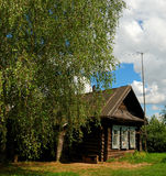 Wooden house in a village. Typical wooden house in a Russian village Stock Images