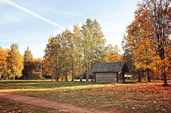 Wooden house in the village - autumn rural colored landscape in sunny weather Royalty Free Stock Photography