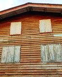 Wooden house vintage retro style. Home building old aged grunge pattern design exterior window closed antique brown structure architecture royalty free stock photos