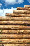 Wooden house wall construction from logs vertical view Stock Photos