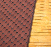 Wooden house wall and part of brown roof tile closeup Stock Photo