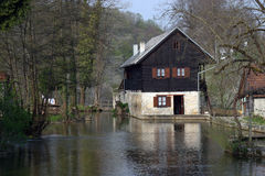 Wooden house in the water. Beautiful wooden house built in the water Stock Photos