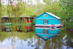 A wooden house by water Royalty Free Stock Images