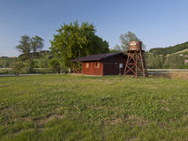 Wooden house and water tower Stock Image
