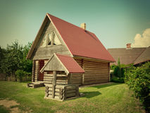 Wooden house and well Royalty Free Stock Image