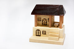 Wooden house on the white background Stock Photos