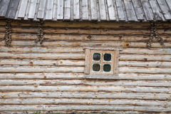 Wooden house and a window Royalty Free Stock Image