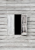 Wooden house. Window in the wall of an old wooden house Stock Image
