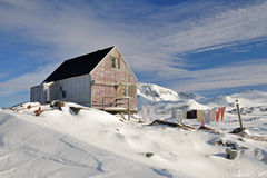 Wooden house in winter. Houses in the Kulusuk village, Greenland Stock Photography