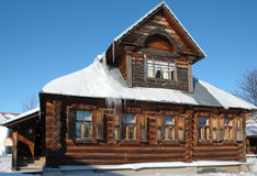 Wooden house in winter. Traditional russian wooden izba in winter. Photo taken in ancient town Suzdal Stock Images