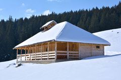 Wooden house in winter Royalty Free Stock Photo