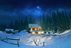 Wooden house in winter forest Stock Photography