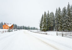 Wooden house on winter forest edge Stock Photos