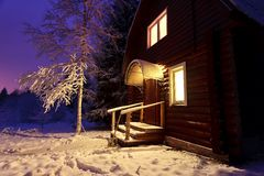 Wooden house in winter forest Stock Photos