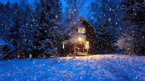 Wooden house in winter forest snofall stock video