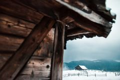 Wooden house in winter forest royalty free stock image
