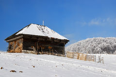 Wooden house in winter landscape Royalty Free Stock Photo