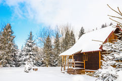 Wooden house during winter Royalty Free Stock Image