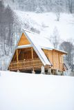 Wooden house at winter Stock Photography