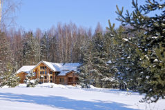 The wooden house in a winter wood Royalty Free Stock Photo