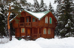 Wooden house in winter wood Stock Photography
