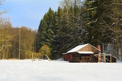 Wooden house in winter wood Stock Photos