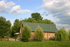 Wooden house in wood stock photography