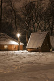 Wooden house in wood in the winter Stock Photography
